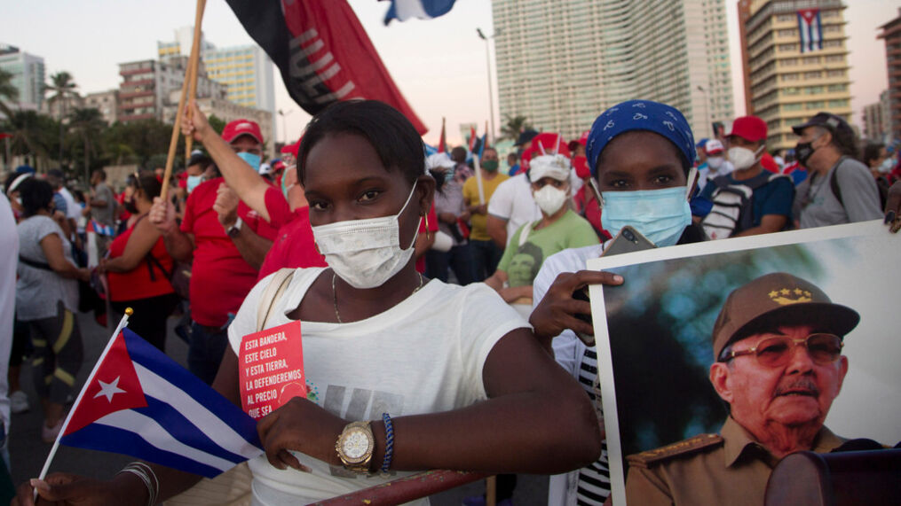 People attend a cultural-political event on the seaside Malecon Avenue with thousands of people in a show of support for the Cuban revolution six days after the uprising of anti-government protesters across the island, in Havana, Cuba, Saturday, July 17, 2021. (AP Photo/Ismael Francisco)