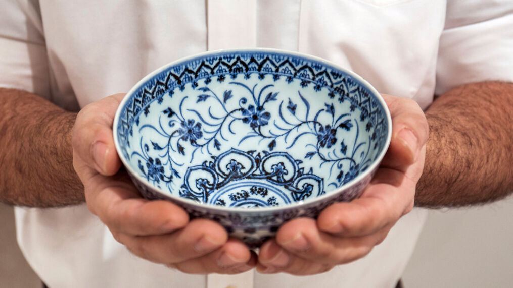 This photo, provided by Sotheby's, in New York, on Tuesday, March 2, 2021, shows a small porcelain bowl bought for $35 at a Connecticut yard sale that turned out to be a rare, 15th century Chinese artifact worth between $300,000 and $500,000. (Sotheby's via AP)