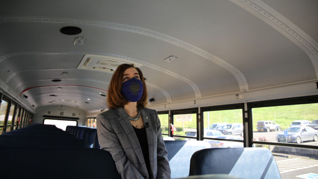 Oregon Gov. Kate Brown stands in school bus at Kalapuya Elementary School on Wednesday, Feb. 24, 2021 during a tour of the school. Bus drivers are taking measures to make sure students are masked up and in the correct seats to slow the spread of the coronavirus as much as possible. (Photo: Governor's Office)