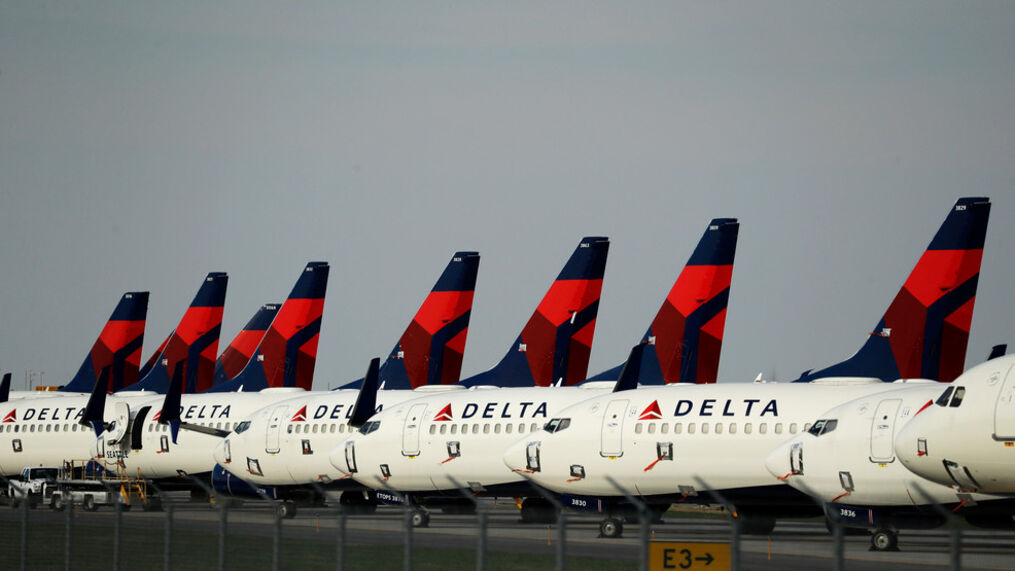 FILE - In this April 1, 2020 file photo, several dozen Delta Air Lines jets are parked at Kansas City International Airport in Kansas City, Mo. (AP Photo/Charlie Riedel, File)