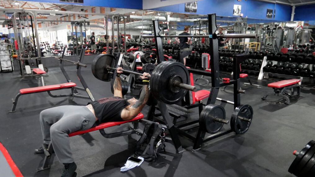 FILE – Daniel Bolling works out at the Downtown Gym, Monday, May 18, 2020, in Orlando, Fla. (AP Photo/John Raoux)