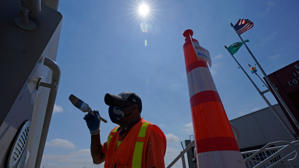 John Ford, a worker with the Port of Seattle, paints near a railing at the Bell Street Cruise Terminal at Pier 66, Wednesday, June 30, 2021, in downtown Seattle. Ford said it was only taking about 10 minutes for his paint to be dry enough to touch. Temperatures cooled considerably in western Washington, Oregon and British Columbia Wednesday after several days of record-breaking heat, but the interior regions of the region were still sweating through triple-digit temperatures as the weather system moved east. (AP Photo/Ted S. Warren)