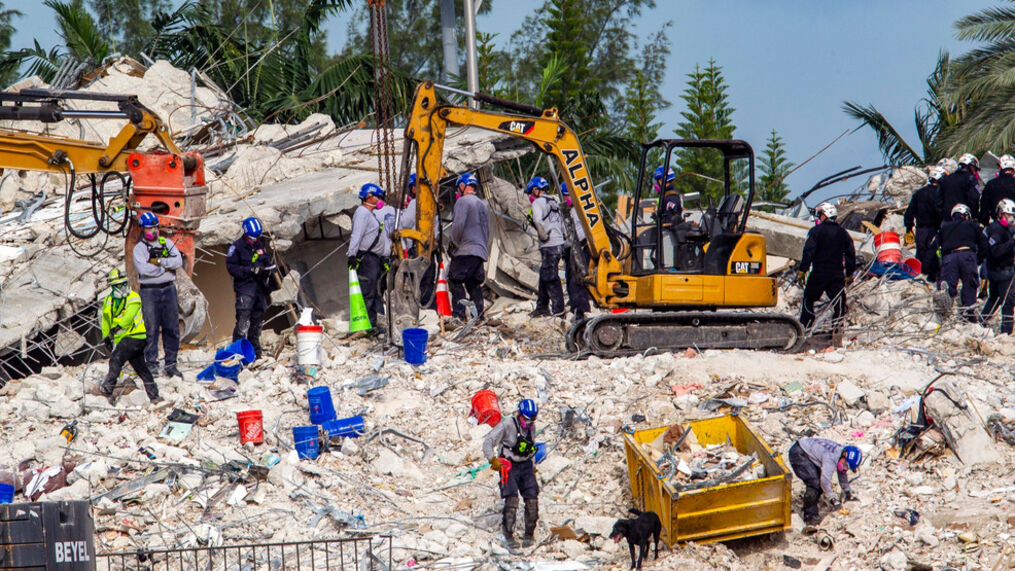 Rescuers search for victims at a collapsed South Florida condo building Monday, July 5, 2021, in Surfside, Fla., after demolition crews set off a string of explosives that brought down the last of the Champlain Towers South building in a plume of dust on Sunday. (Pedro Portal/Miami Herald via AP)