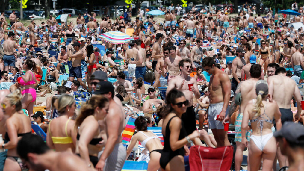 FILE - In this June 5, 2021, file photo, crowds gather on L Street Beach in the South Boston neighborhood of Boston. (AP Photo/Michael Dwyer)