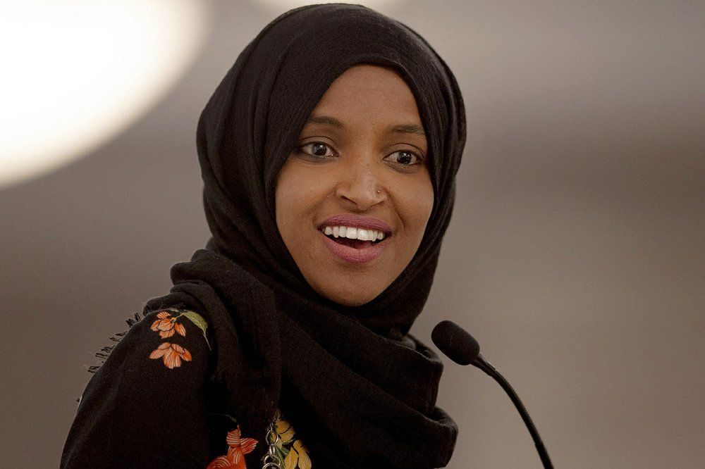 FILE - In this May 18, 2019, file photo, Rep. Ilhan Omar, D-Minn., speaks during the fourth annual Citywide Iftar Dinner in Austin, Texas. In tweets Sunday, President Donald Trump portrays the lawmakers as foreign-born troublemakers who should go back to their home countries. In fact, the lawmakers, except one, were born in the U.S. He didn't identify the women but was referring to Reps. Alexandria Ocasio-Cortez, Ilhan Omar, Ayanna Pressley and Rashida Tlaib. (Nick Wagner/Austin American-Statesman via AP, File)