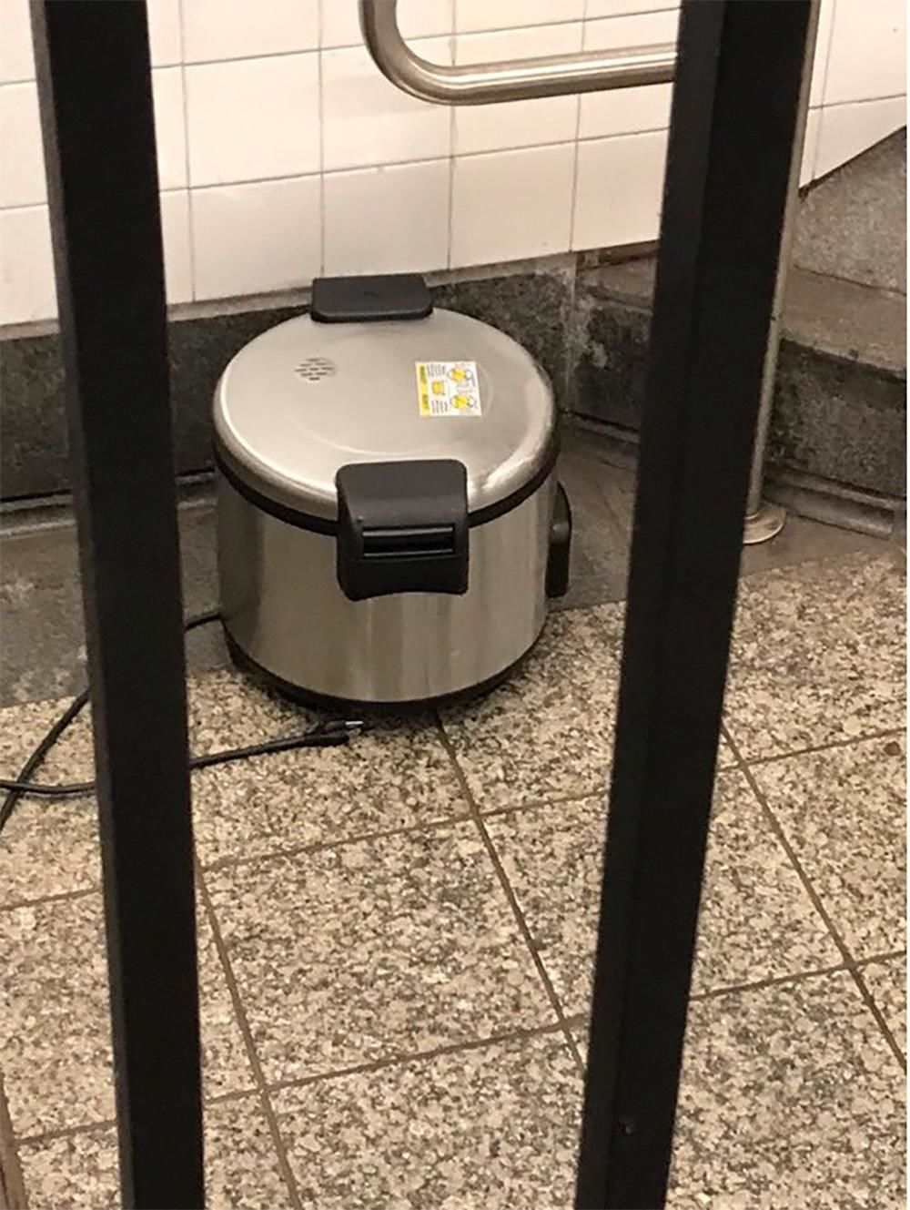 This photo provided by NYPD shows a suspicious object which looks like a pressure cooker or electric crockpot on the floor of the New York City Subway platform on Friday, Aug. 16, 2019 in New York. (NYPD via AP)