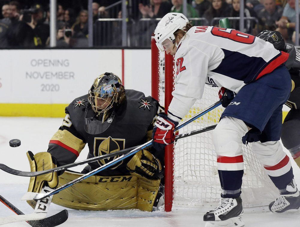 Washington Capitals forward Carl Hagelin shoots as Vegas Golden Knights goalie Marc-Andre Fleury defends during the first period of an NHL hockey game Monday, Feb. 17, 2020, in Las Vegas. (AP Photo/Isaac Brekken)