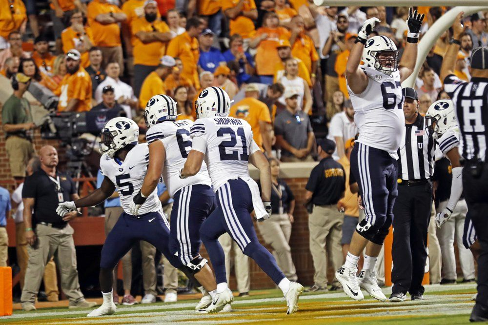 Brigham Young University fans will be getting half off pizza from Papa John's if they keep up their winning streak this season. (File Photo: Associated Press)