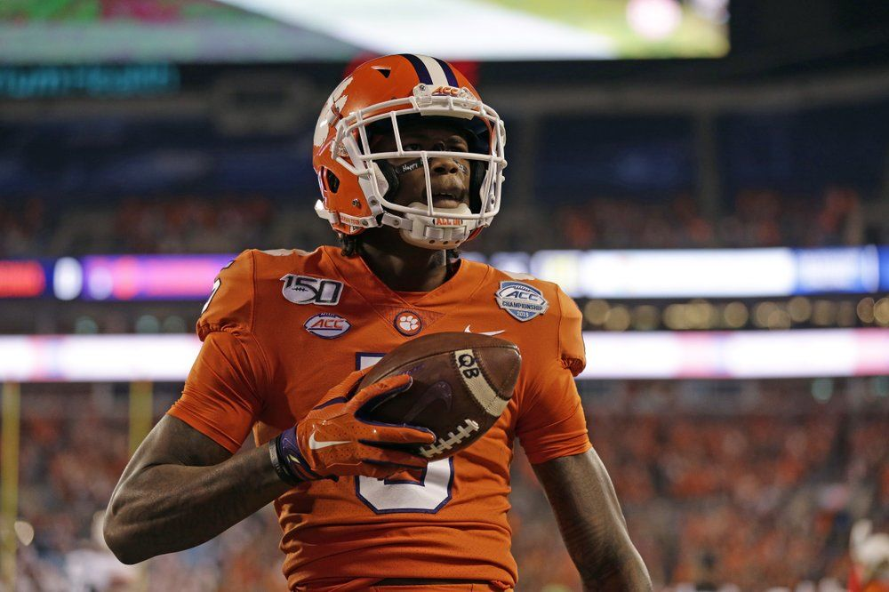 Clemson wide receiver Tee Higgins (5) reacts following his touchdown against Virginia duriung the first half of the Atlantic Coast Conference championship NCAA college football game in Charlotte, N.C., Saturday, Dec. 7, 2019. (AP Photo/Gerry Broome)