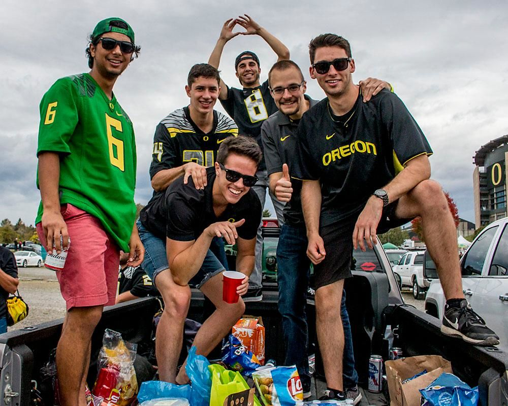 Oregon Ducks fans tailgate in the back end of a truck on Saturday afternoon in the parking lot of Autzen Stadium . Katie Pietzold, Oregon News Lab
