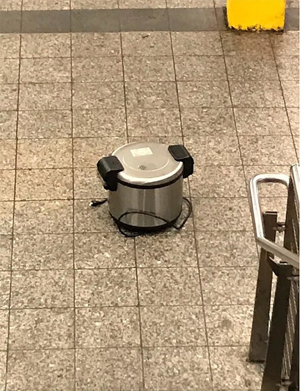 This photo provided by NYPD shows a suspicious object which looks like a pressure cooker or electric crockpot on the floor of the New York City Subway platform on Friday, Aug. 16, 2019 in New York.{ } (NYPD via AP)
