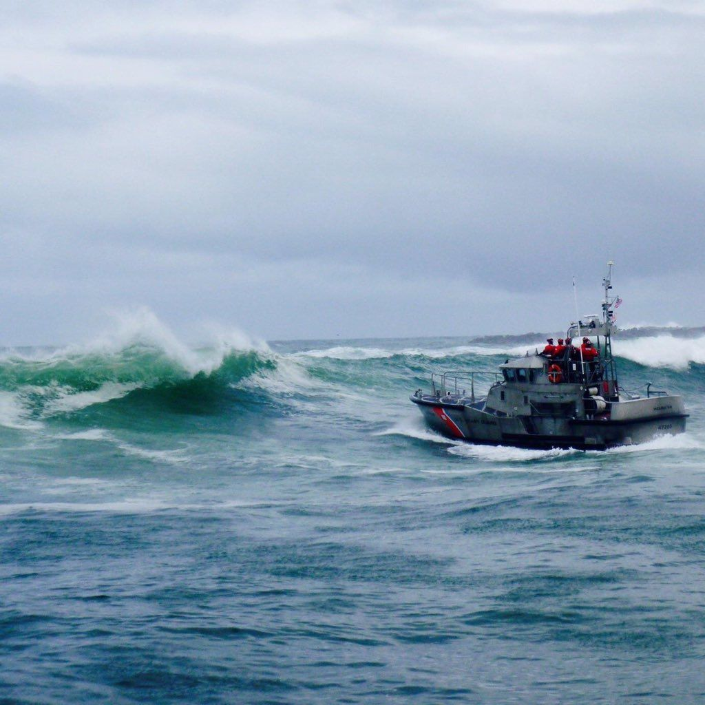 U.S. Coast Guard Air Facility Newport and Station Yaquina Bay boat crews responded to 3 fishermen in the water after commercial fishing vessel Mary B II capsizes while crossing Yaquina Bay Bar on Jan. 8, 2018. Crews were battling 12 to 14-foot seas. Photo courtesy U.S. Coast Guard Pacific Northwest{ }