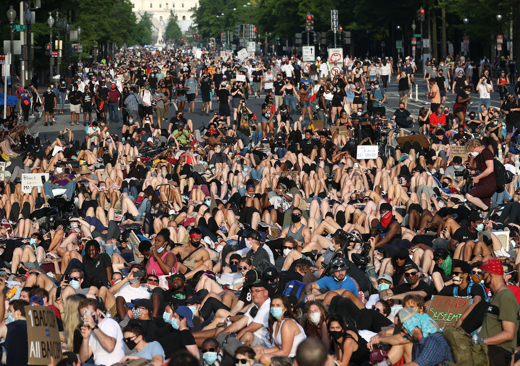 WASHINGTON, DC - JUNE 03: Demonstrators lay down on Pennsylvania Avenue during a peaceful protest against police brutality and the death of George Floyd, on June 3, 2020 in Washington, DC. Protests in cities throughout the country have been held after the death of George Floyd, a black man who was killed in police custody in Minneapolis on May 25.  (Photo by Win McNamee/Getty Images)