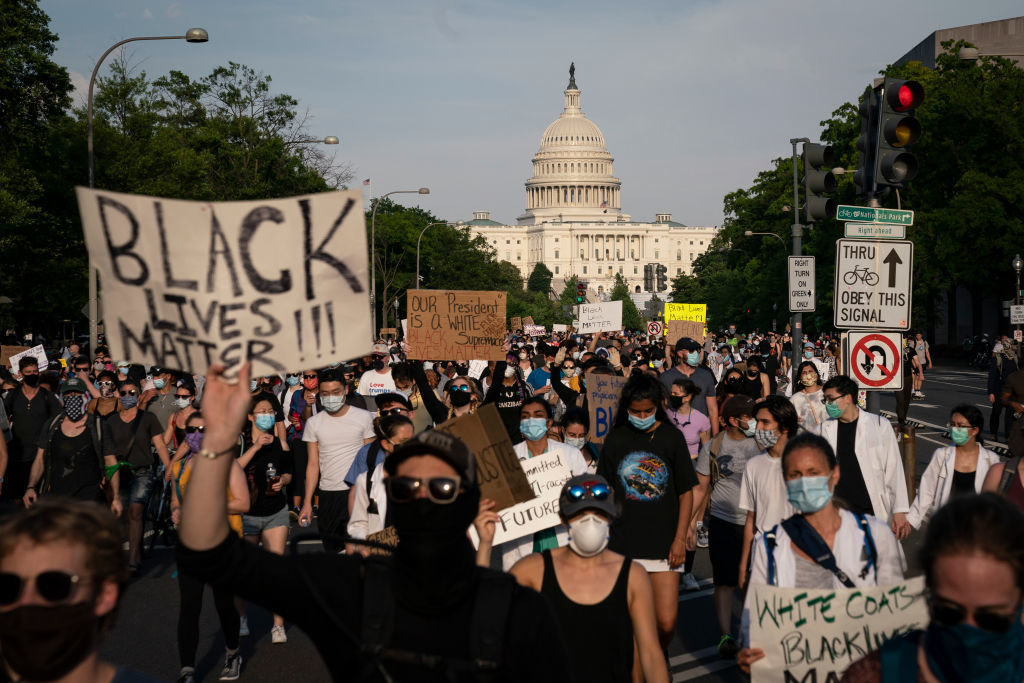 WASHINGTON, DC - JUNE 03: Demonstrators peacefully march down Pennsylvania Avenue after leaving the U.S. Capitol on June 3, 2020 in Washington, DC. Protests in cities throughout the country continue in the wake of the death of George Floyd, a black man who was killed in police custody in Minneapolis on May 25. (Photo by Drew Angerer/Getty Images)