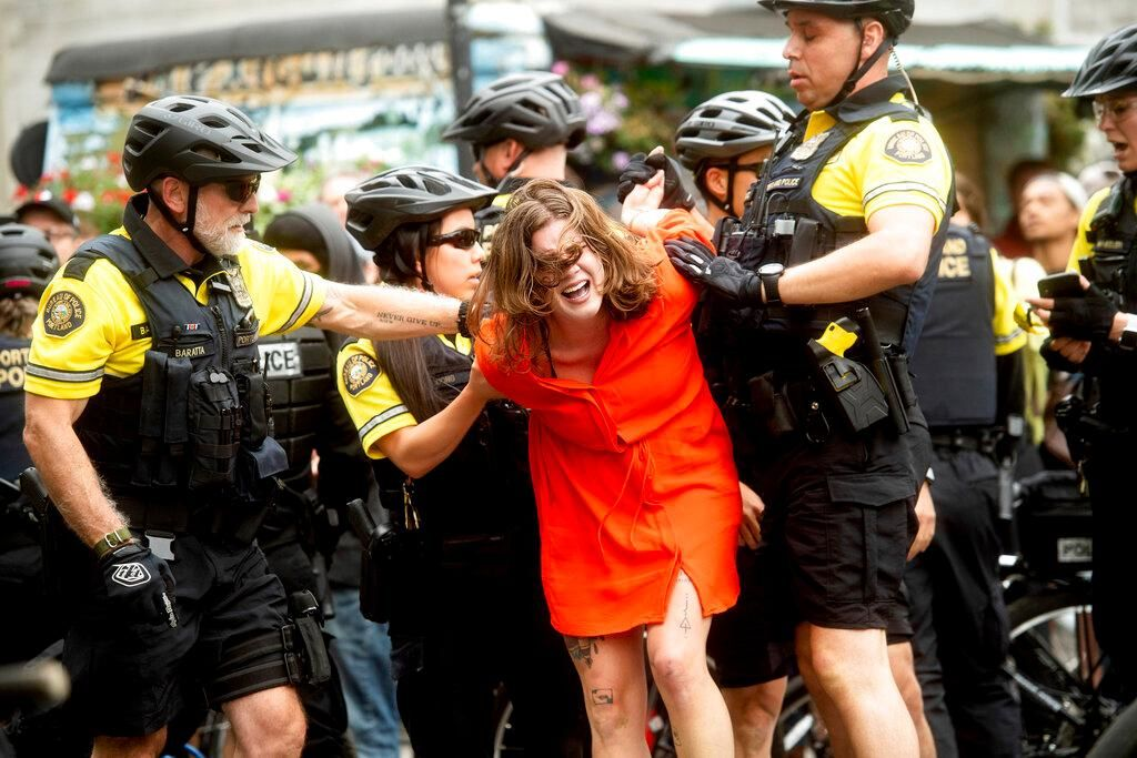"Police officers detain a protester against right-wing demonstrators following an ""End Domestic Terrorism"" rally in Portland, Ore., on Saturday, Aug. 17, 2019. Although the main protest remained largely peaceful, some skirmishes erupted in the following hours and police detained multiple protesters. (AP Photo/Noah Berger)"
