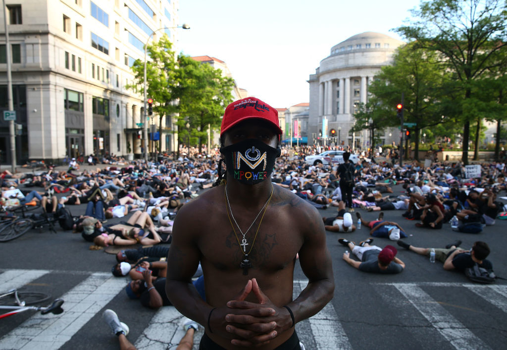 WASHINGTON, DC - JUNE 03: Demonstrators lay down at 15th St. near Pennsylvania Avenue during a peaceful protest against police brutality and the death of George Floyd, on June 3, 2020 in Washington, DC. Protests in cities throughout the country have been held after the death of George Floyd, a black man who was killed in police custody in Minneapolis on May 25.  (Photo by Tasos Katopodis/Getty Images)