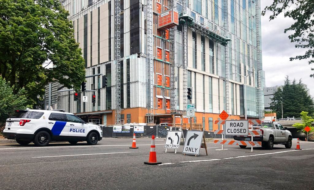 A road closure sign is seen in downtown Portland, Ore., Friday, Aug. 16, 2019, in advance of a rally as the city prepares for crowds. In the past week, authorities in Portland have arrested a half-dozen members of right-wing groups on charges related to violence at previous politically motivated rallies as the liberal city braces for potential clashes between far-right groups and self-described anti-fascists who violently oppose them. (AP Photo/Gillian Flaccus)