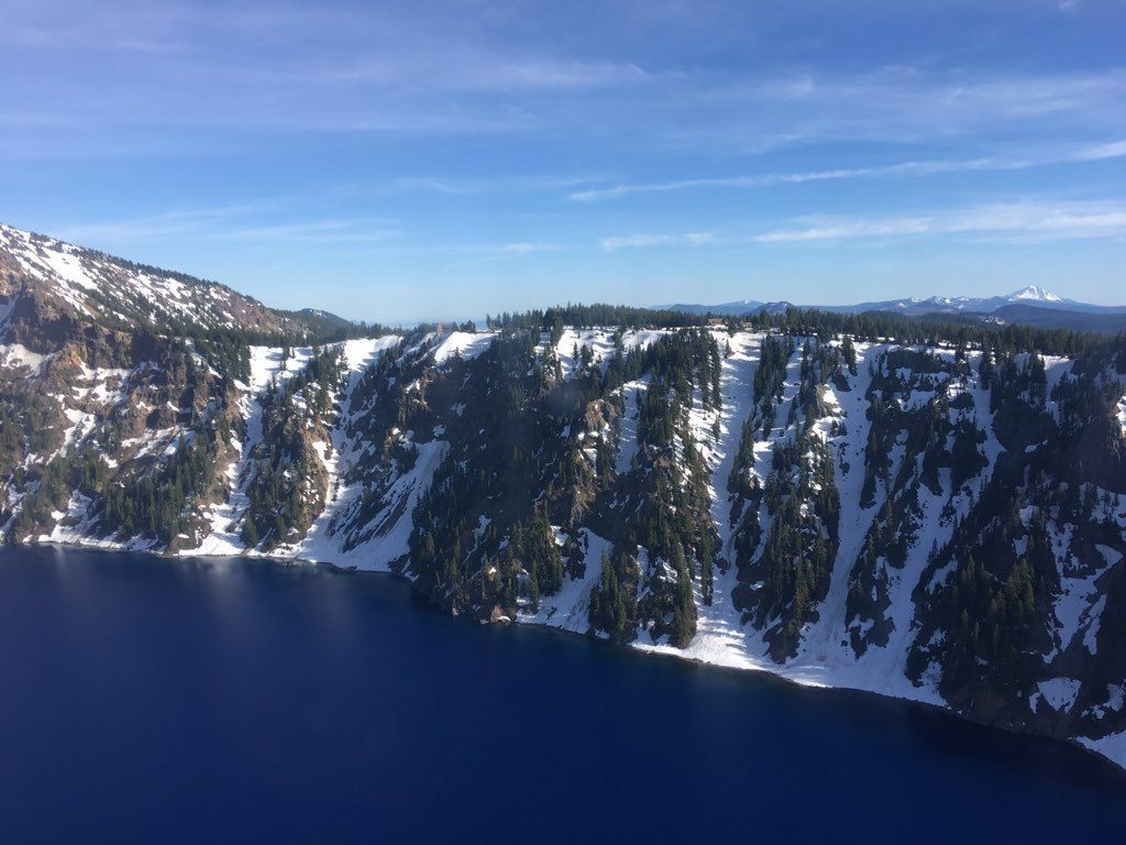Aerial view of the caldera of Crater Lake National Park near Rim Village Crater Lake National Park, Oregon, June 10, 2019.A Coast Guard MH-65 Dolphin helicopter aircrew rescued a man who fell approximately 800 feet into the caldera of Crater Lake.U.S. Coast Guard photo courtesy of Sector North Bend.
