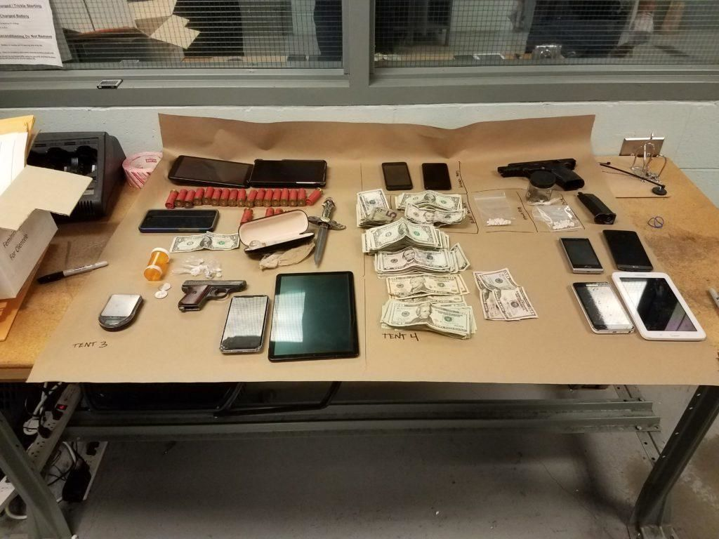 <p>Evidence seized from search warrants served at 2nd Avenue S and S Washington (SPD photo)</p>