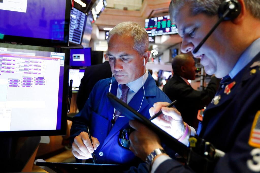Trader Timothy Nick, left, works on the floor of the New York Stock Exchange, Friday, Sept. 13, 2019. Stocks are having a mixed performance early on Wall Street Friday as gains in banks and energy companies are offset somewhat by a drop in technology stocks. (AP Photo/Richard Drew)
