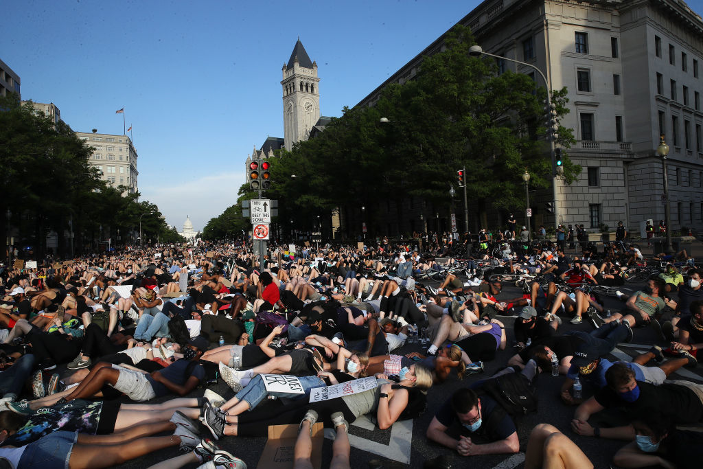 WASHINGTON, DC - JUNE 03: Demonstrators lay down on Pennsylvania Avenue during a peaceful protest against police brutality and the death of George Floyd, on June 3, 2020 in Washington, DC. Protests in cities throughout the country have been been held after the death of George Floyd, a black man who was killed in police custody in Minneapolis on May 25.  (Photo by Win McNamee/Getty Images)