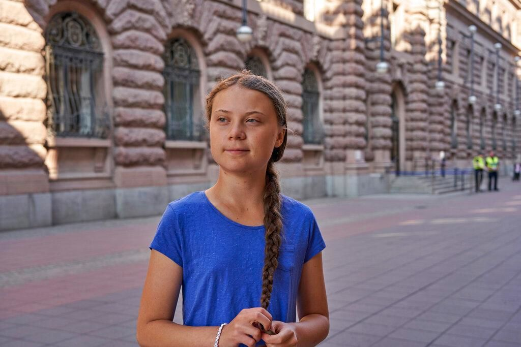 FILE- In this photo taken on Friday, July 26, 2019, Greta Thunberg stands next to Swedish parliament in Stockholm.{ } (AP Photo/David Keyton)