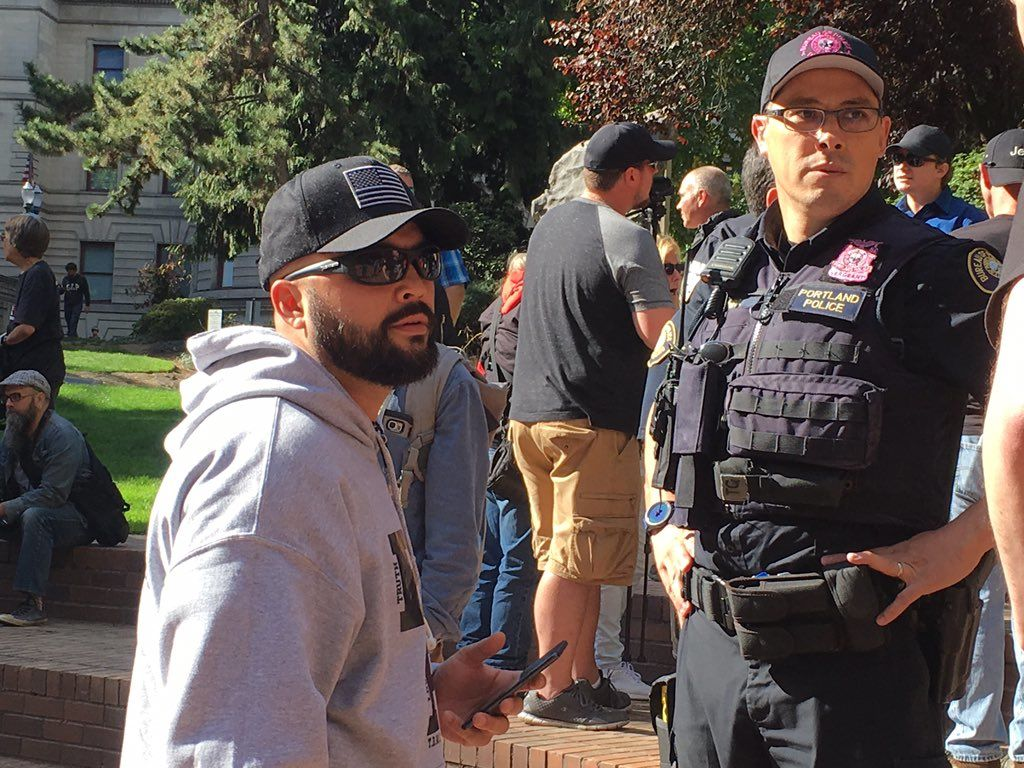 'Joey Gibson, organizer for the Patriot Prayer group, says he condemns racism and violence' - Tweet from Catherine Van on October 8, 2017.jpg