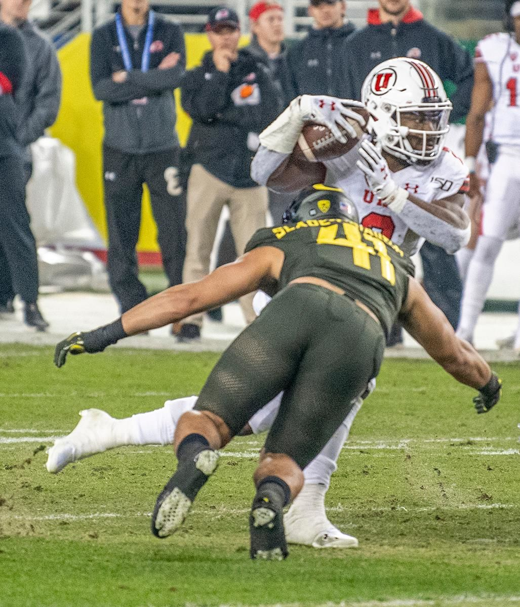 Oregon's middle linebacker Isaac Slade-Matautia, #41, wraps up on Utah's running back Zack Moss, #2, after a short gain.  The University of Oregon Ducks defeated the University of Utah Utes 37-15 for the Pac 12 Championship Friday night at Levi's Stadium. Oregon's running back CJ Verdell, #7, rushed for 203 all-purpose yard along with three touchdowns for the night. Verdell was named the games M-V-P for his performace. Oregon's safey Brady Breeze, #25, contributed 9 tackles and one interception. Oregon's defensive end Kayvon Thibodeaux, #5, sacked Utah's quarterback Tyler Huntly, #1, for a total of three times. Oregon's quarterback Justin Herbert, #10, passed for 193 yards with one touchdown. The Oregon Ducks will represent the Pac 12 for the upcoming Rose Bowl game in the new year. Photo by Jeffrey Price