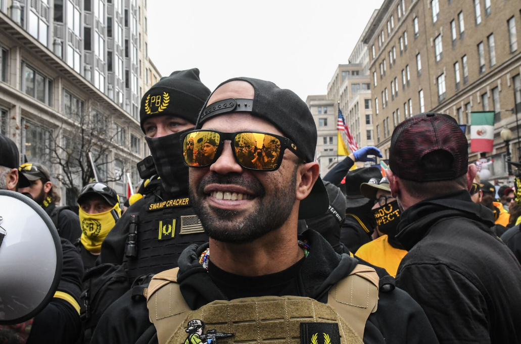 <p>FILE-  Enrique Tarrio, leader of the Proud Boys, stands outside Harry's bar during a protest on December 12, 2020 in Washington, DC. (Photo by Stephanie Keith/Getty Images)</p>