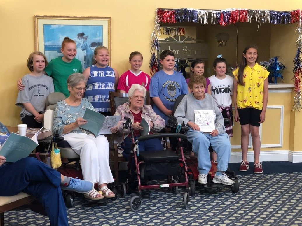 Students from Club Impact donated 25 copies to residents at Baywinde Senior Living Community in Webster. (Photo: Webster CSD)