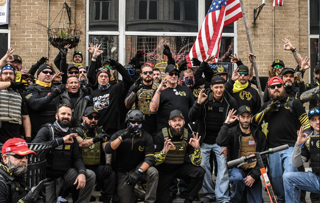 <p>FILE- Members of the Proud Boys pose for a photo while flashing a gesture associated with the white power movement outside of Harry's bar during a protest on December 12, 2020 in Washington, DC.  (Photo by Stephanie Keith/Getty Images)</p>