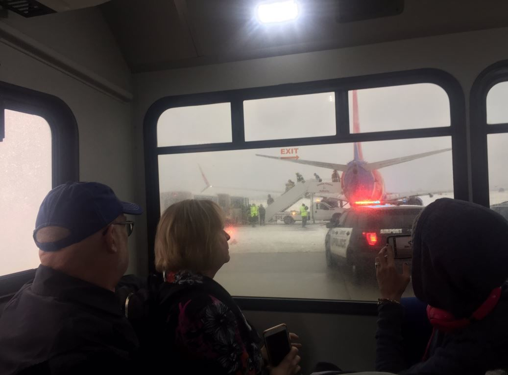Passengers are shuttled to the terminal at Eppley Airfield after a flight from Las Vegas slid off the runway Friday, Jan. 18, 2019. (Courtesy: Patrick Forrey)