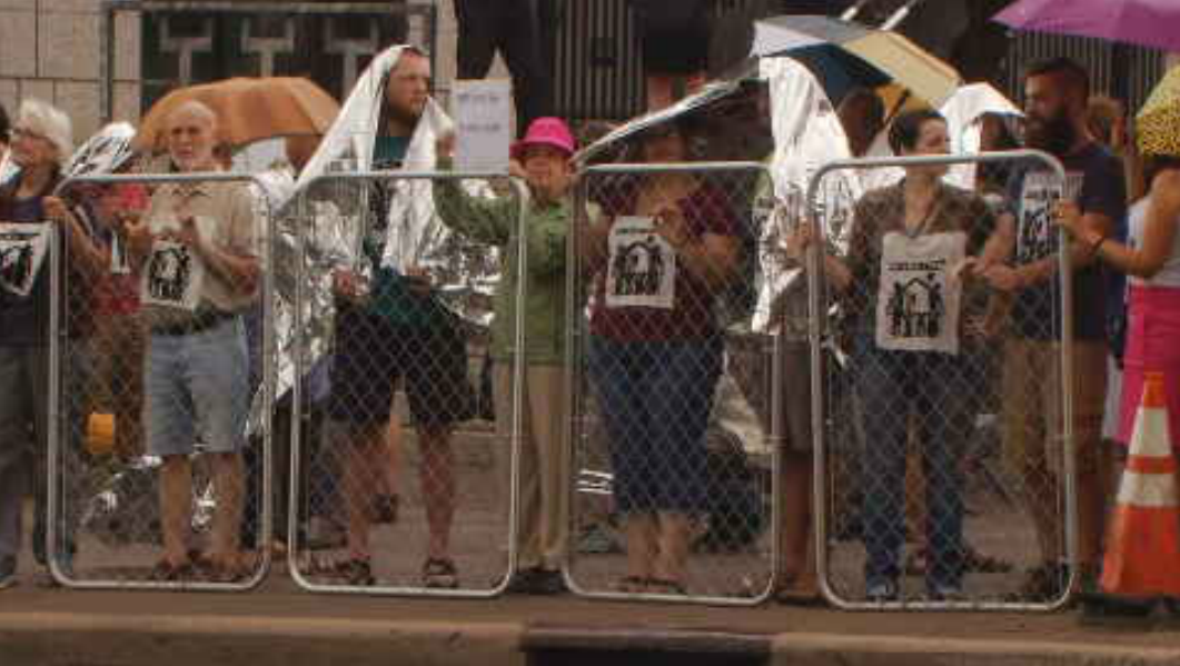 Protests broke out in Asheville a day after President Donald Trump signed an executive order directing the Department of Homeland Security to begin detaining families together instead of separating parents and children. (Photo credit: WLOS staff)<p></p>