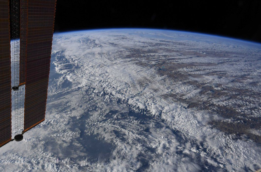 Clouds like filaments caught on the Himalayan peaks, as the wind blows humid air from the low-lying plains to the south across the mountains up onto the dry Tibetan plateau to the north. (Photo & Caption David Saint-Jacques, NASA)