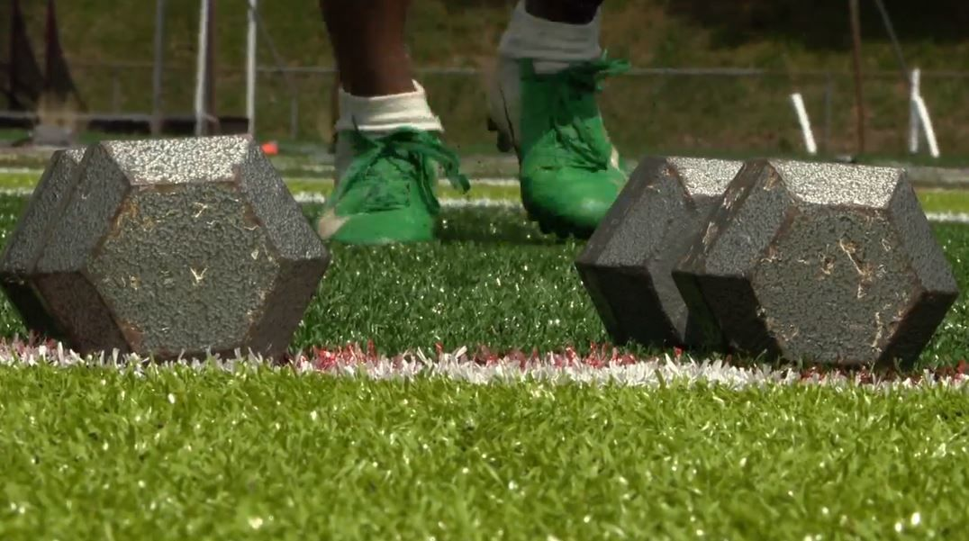 Asheville City Schools is suspending summer workouts after four athletes tested positive for COVID-19. (Photo credit: WLOS staff)