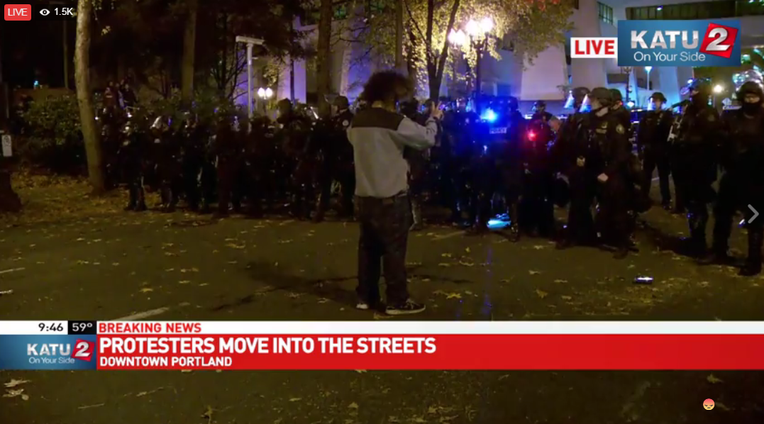 Police use flash bangs on protesters (KATU News photo)