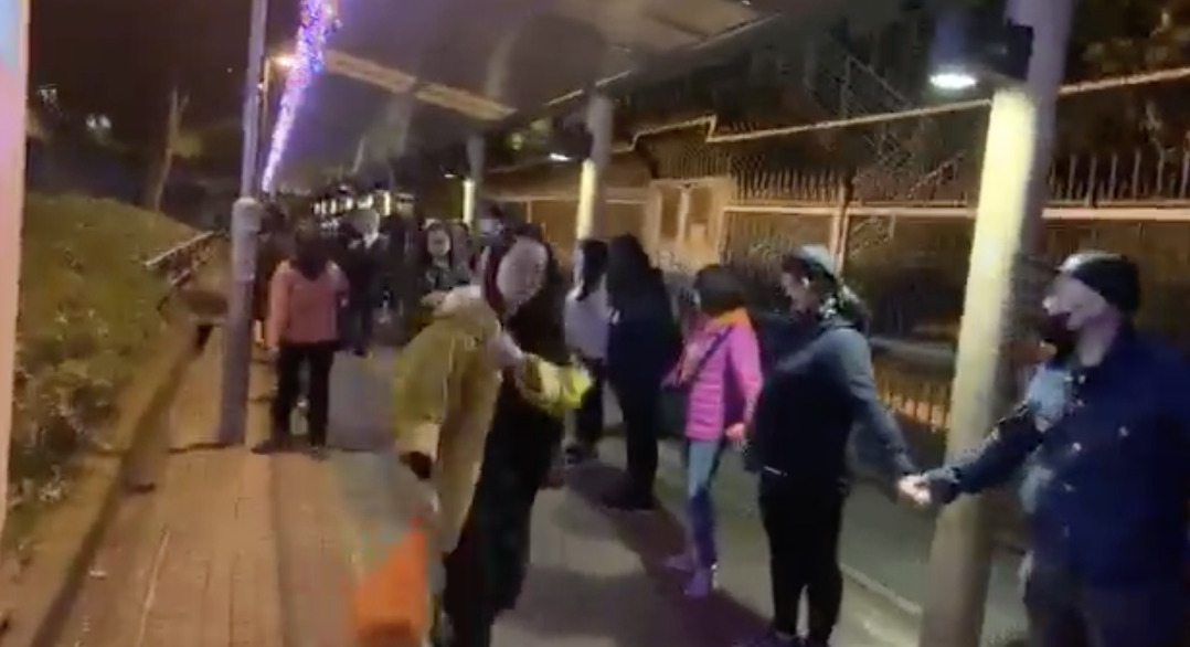 More than 1,000 protesters formed human chains across various locations in Hong Kong on Tuesday, Dec. 31, 2019, to rally fireworks canceled for New Year's Eve celebration. (SocREC via Storyful)