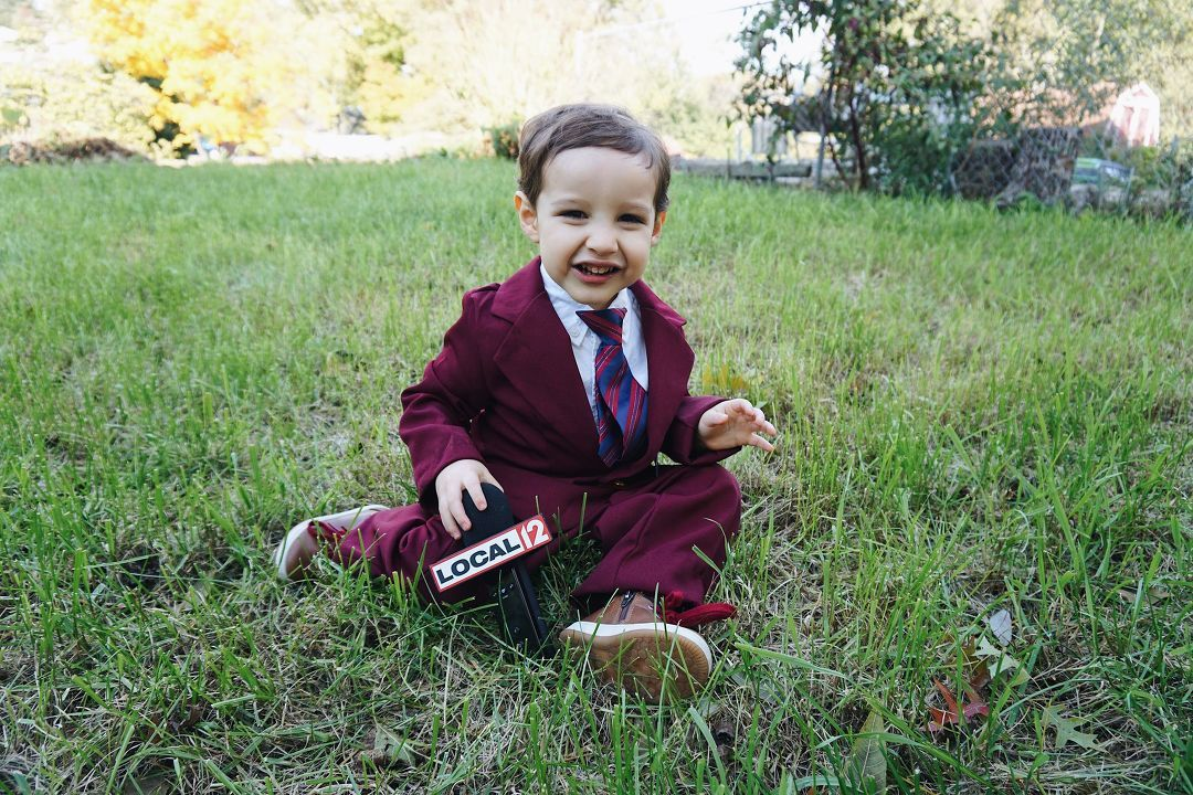 Calvin dressed up as anchorman for Halloween