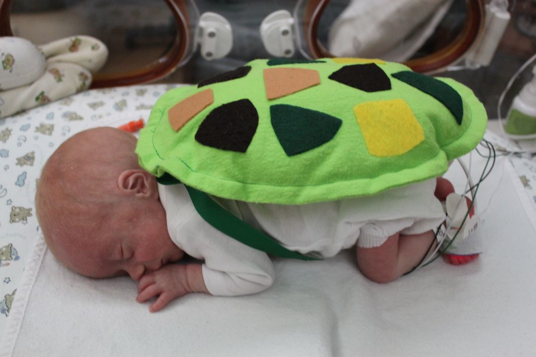 This is Nate, he was born 10 weeks early at Miami Valley hospital in Dayton. Nate was born on 9/21 at 2lbs 1oz and now is 4lbs!! The nurses and staff made Halloween costumes for the babies this year and held a trick or treat for siblings. He was the cutest turtle! He will hopefully be coming home soon! - Stephanie Hensley