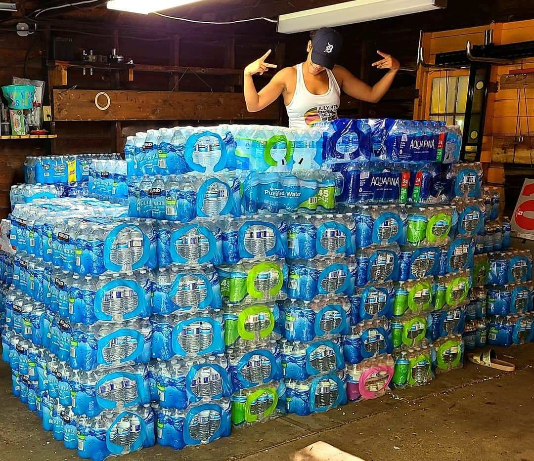 Tamara Custard sits on more than{ } 200 cases of water in her garage July 23, 2020, a week after she started collecting the bottles. She anticipates collecting until Aug. 7, 2020. (WWMT/Courtesy Tamara Custard)
