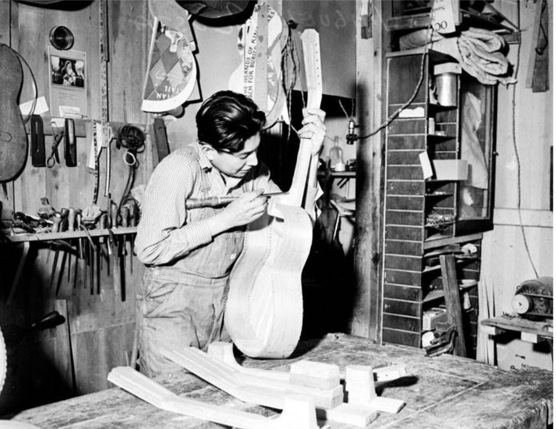 Miguel Acosta is shown trimming down the neck of a guitar at the Acosta Music Company shop back in 1937.{ }(Photos courtesy San Antonio Light Collection/UTSA Libraries Special Collections)