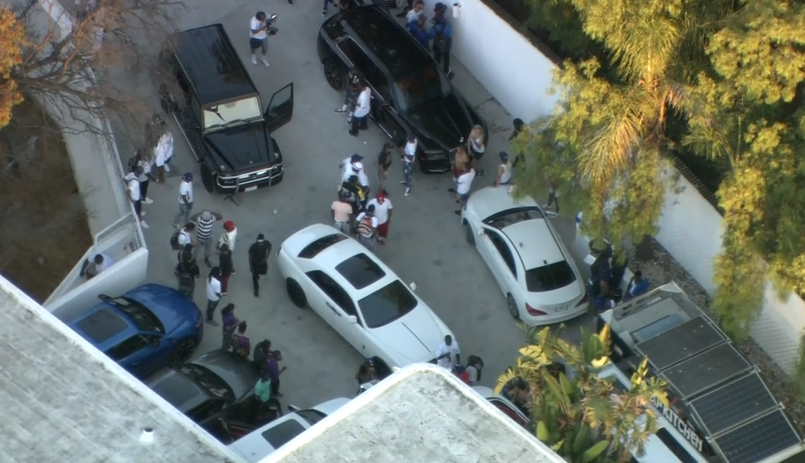 Aerials show a crowd of people at a mansion in Beverly Crest, California, near Beverly Hills, on Tuesday, August 4 which was cited as a reason for a crackdown on large gatherings in Los Angeles (KCAL//CNN Newsource)