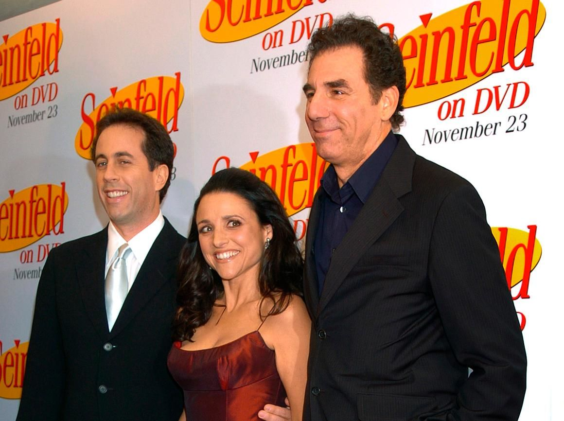"FILE - In this Nov. 17, 2004, file photo Jerry Seinfeld, left, Julia Louis Dreyfus and Michael Richards arrive to celebrate the release of the first three seasons of Seinfeld on DVD in New York. Netflix says it will start streaming all 180 episodes of the ""Seinfeld"" in 2021, gaining a hugely popular addition to its library as the battle for viewers heats up. (AP Photo/ Louis Lanzano, File)"