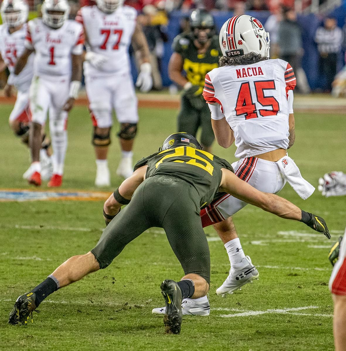 Oregon's safety Brady Breeze, #25, lays a big hit on Utah's wide receiver Samson Nacuam #45, after a catch. The University of Oregon Ducks defeated the Utah Utes 37-15 for the Pac 12 Championship Friday night at Levi's Stadium. Oregon's running back CJ Verdell, #7, rushed for 203 all-purpose yard along with three touchdowns for the night. Verdell was named the games M-V-P for his performace. Oregon's safey Brady Breeze, #25, contributed 9 tackles and one interception. Oregon's defensive end Kayvon Thibodeaux, #5, sacked Utah's quarterback Tyler Huntly, #1, for a total of three times. Oregon's quarterback Justin Herbert, #10, passed for 193 yards with one touchdown. The Oregon Ducks will represent the Pac 12 for the upcoming Rose Bowl game in the new year. Photo by Jeffrey Price