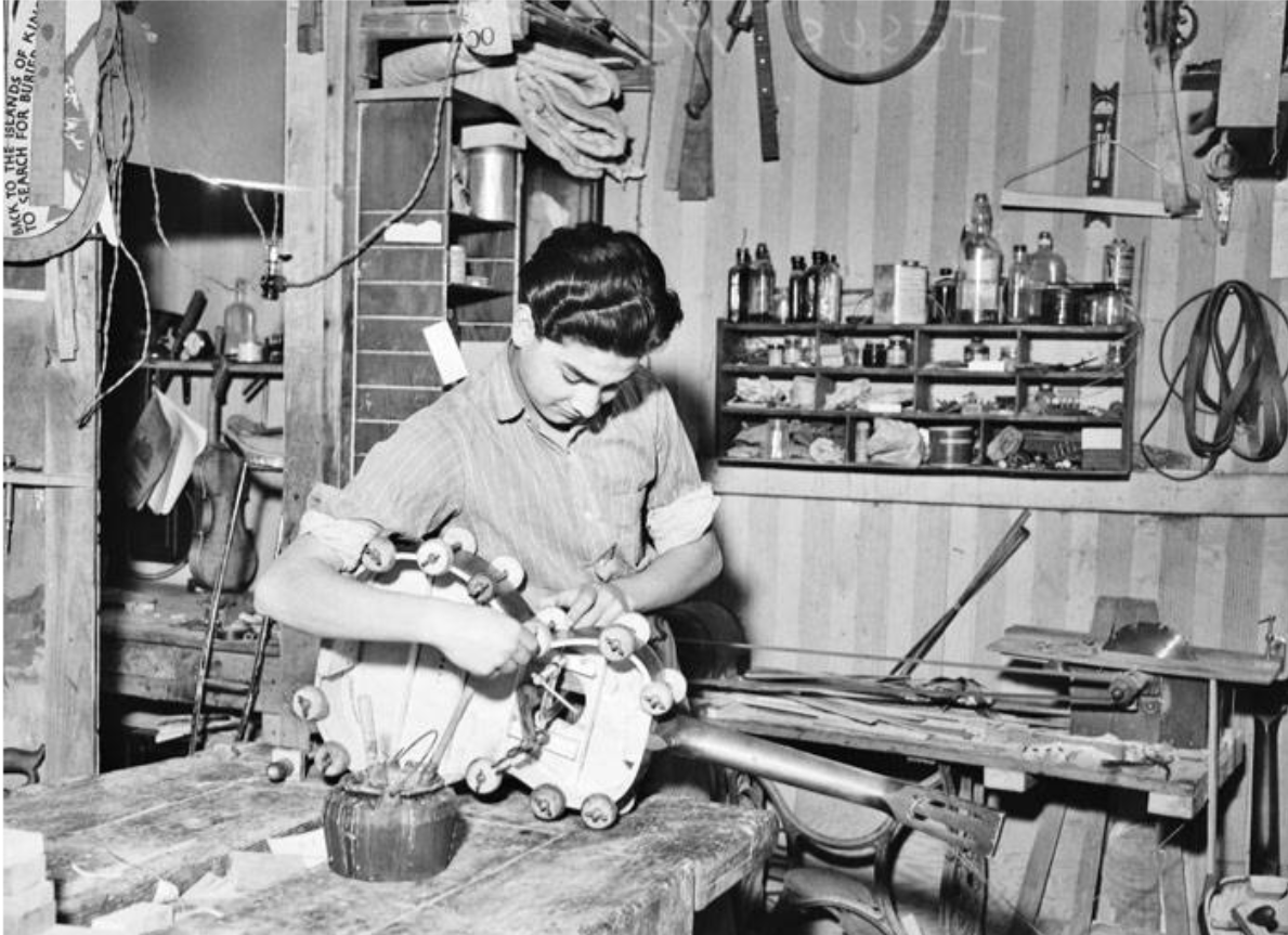 Jesus Acosta is shown gluing the body of a guitar at Acosta Music Company shop back in 1937.{ }(Photos courtesy San Antonio Light Collection/UTSA Libraries Special Collections)