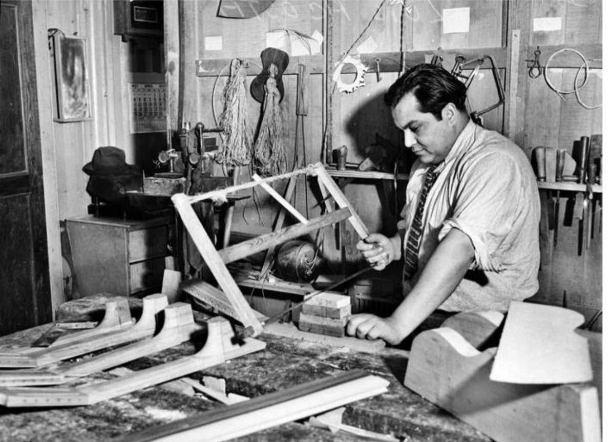 Luis Acosta is working with homemade saw to cut out the neck of a guitar back in 1937.{ }(Photos courtesy San Antonio Light Collection/UTSA Libraries Special Collections)