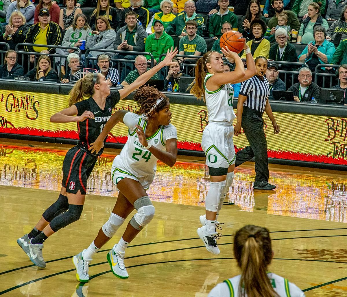 Oregon's point guard Sabrina Ionescu, #20, drains mid-range jumper to become the all-time leading scorer for the University of Oregon women's basketball program. The #6 University of Oregon Ducks women's basketball team defeated #3 Stanford Cardinal 87-55 in front of a sold out crowd of 12, 218 fans in Matthew Knight Arena. Sabrina Ionescu broke the all-time Oregon scoring record of 2,253 and ended the game with 37 points, 11 rebounds, another double-double. Satou Sabally added 18 points and 11 rebounds, also a double-double. Ruthy Hebard put up 11 points with 5 rebounds, and Minyon Moore added 10 points 3 rebounds. The Ducks next face off against Cal on Sunday, January 19, at 2 pm in Matthew Knight Arena. Photo by Jeffrey Price