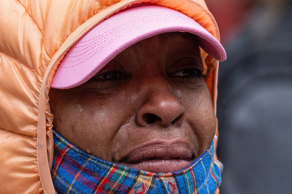 SEATTLE, WA - MAY 31: A demonstrator cries during a gathering to protest the recent death of George Floyd on May 31, 2020 in Seattle, Washington. Protests began peacefully Sunday after days of violent scenes in the city. (Photo by David Ryder/Getty Images)