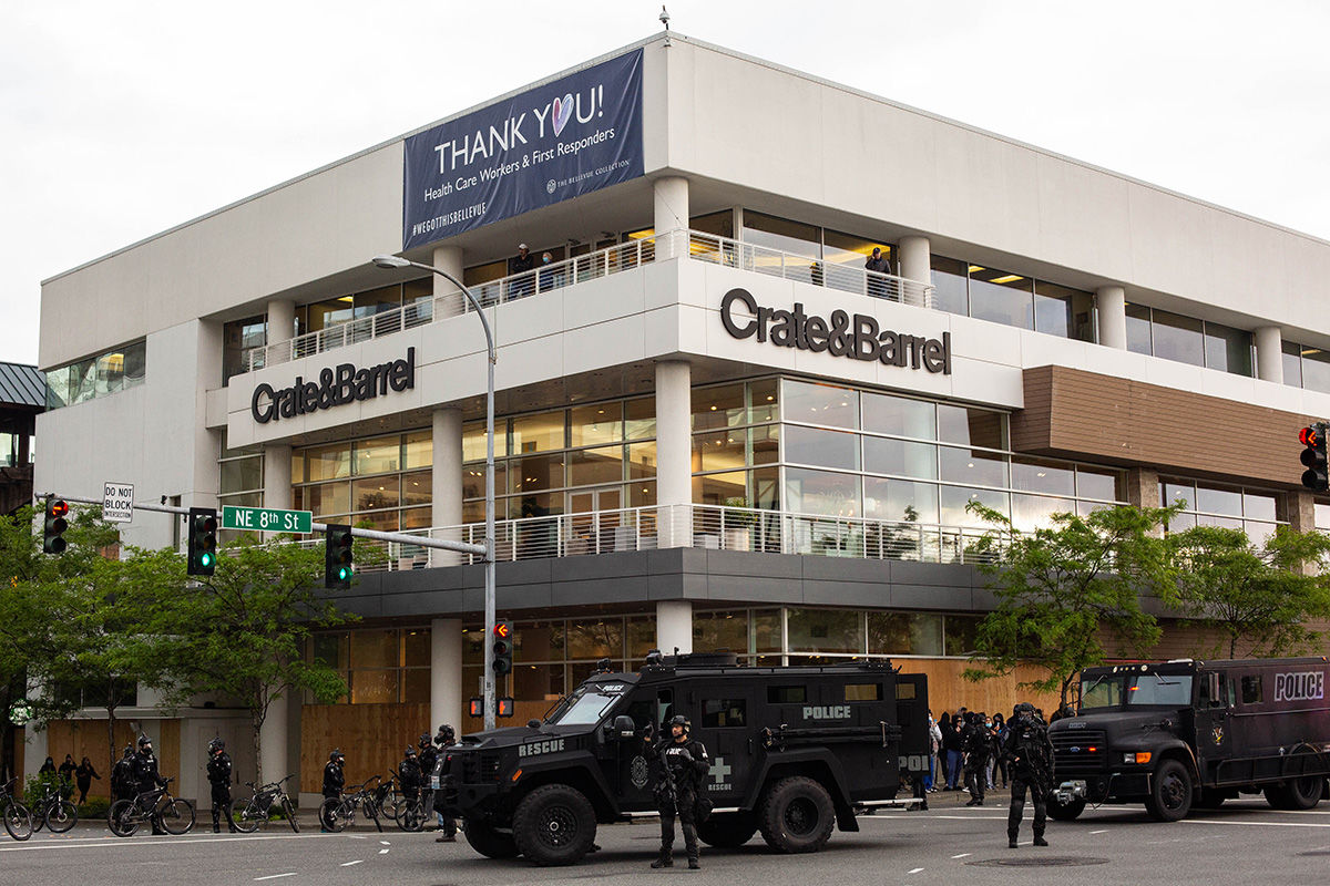 BELLEVUE, WA - MAY 31: Police stand near armored vehicles outside of Bellevue Square Mall after looting took place on May 31, 2020 in Bellevue, Washington. Protests due to the recent death of George Floyd took place in Bellevue in addition to Seattle, with looting in Bellevue and at least one burned automobile there. (Photo by David Ryder/Getty Images)