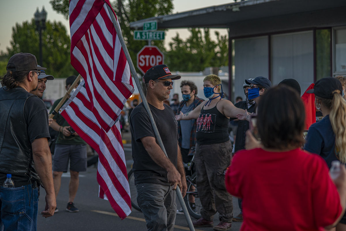 The two sides met in the middle of the road many times over the night. About 250 people gathered at the Springfield, Oregon, library for what was billed as an All Lives Matter rally Friday at 7 p.m. About a dozen counter protesters also attended. The event was mostly peaceful, although a couple of minor scuffles broke out and one man was taken into custody by the Springfield police. By 9:30 p.m. both the protesters and the counter protesters dispersed. Photo by Jeremy Williams